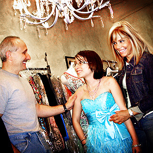 Jim Rogan, with store owner Bianca Simone, right, with daughter Jessica who walked as a model in the fashion show